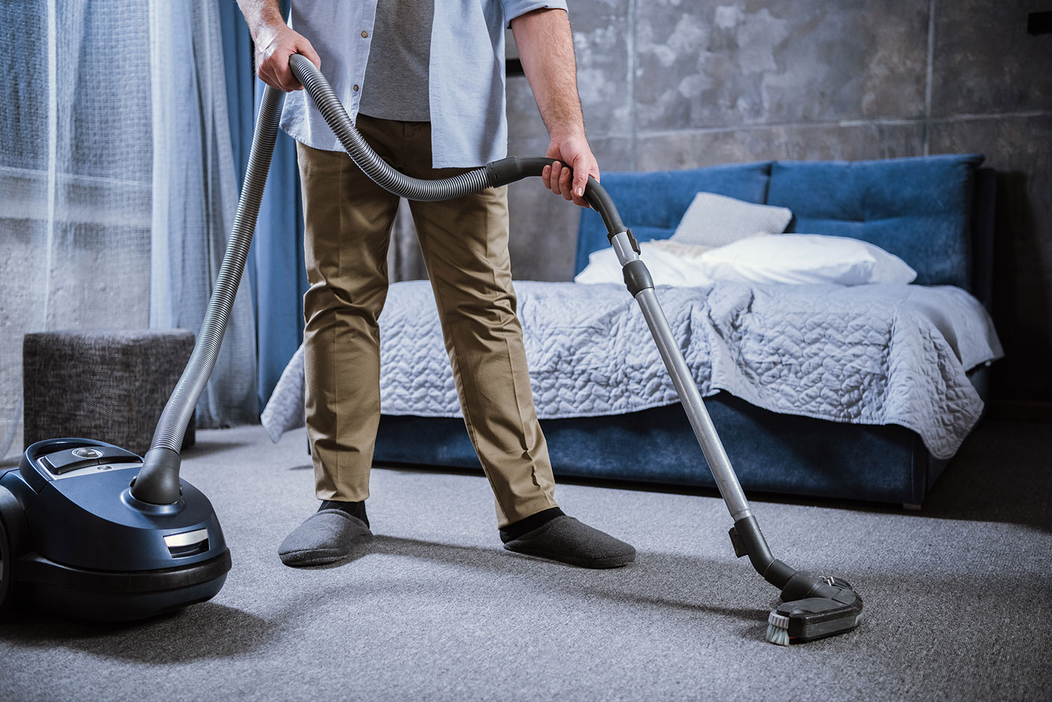 man-with-vacuum-cleaner-cleaning